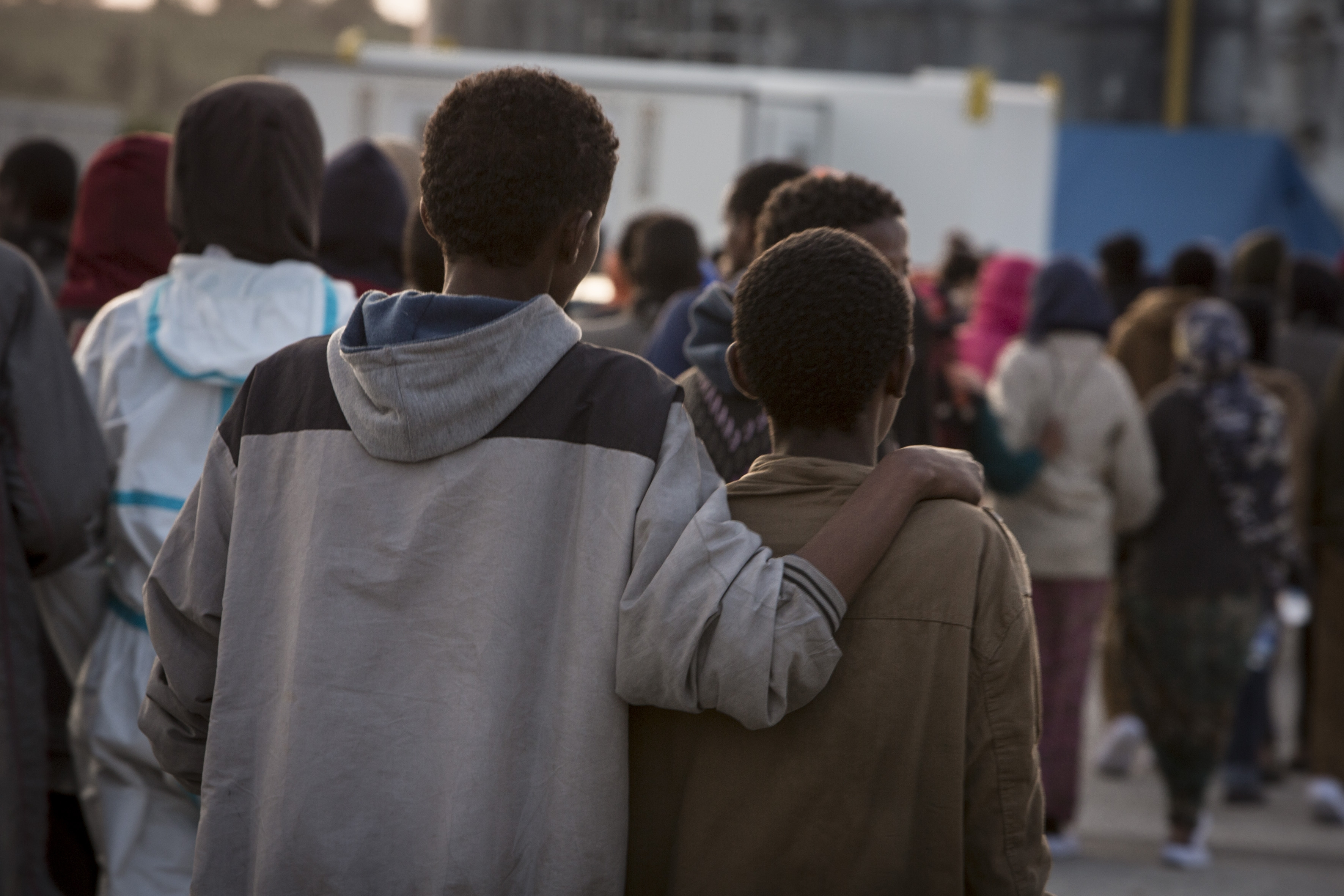 Migrants arrive at the Italian port of Augusta in Sicily. They are greeted by Save the Children staff whilst awaiting processing by Italian authorities.