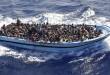 Profughi di origine Subsahariana a bordo di un barcone, Mar Mediterraneo Meridionale, 11 Settembre 2014. Nel corso dell'operazione 'Mare Nosrum' la Fregata Euro ha individuato e prestato soccorso a due barconi con 956 persone.  ANSA/GIUSEPPE LAMI
