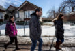 """Kevork Eleyjian, centre, and his sisters Lara, left, and Houry, right, walk down the streets of Laval, Quebec on Saturday, March 12, 2016. The three siblings use Saturday to take care of their household tasks. """"I feel very welcome here,"""" Kevork said. """"People at the airport all clapped when we arrived."""" ; Since November 4, 2015, 26,176 Syrian refugees have arrived in Canada, fleeing the war in Syria."""